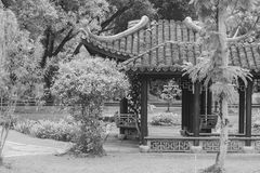 Chinese pagoda surrounded with green trees at public park. & x28;Black and White filter effect& x29 royalty free stock image