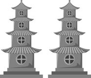 Chinese pagodas. Two decorative Chinese pagodas with circular windows and tiered roofs Royalty Free Stock Photo