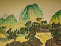 Chinese painting. This is my own painting, watercoloured painting in traditions of old chinese art. Mountains, pine-trees and a house Stock Images