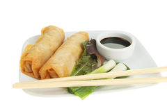 Chinese pancake rolls and chopsticks Royalty Free Stock Photo