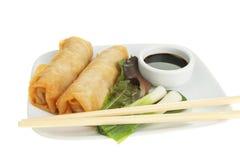 Chinese pancake rolls and chopsticks Royalty Free Stock Photo