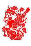 Chinese paper-cut bird. Paper-cut is a picture cut on a paper with scissors. The picture patterns are often pasted on the lintels, windows or lanterns to express Stock Photo