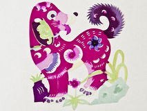 Chinese paper cutting dog. A color Chinese paper cutting dog with some flowers Royalty Free Stock Images