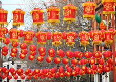 Chinese paper lamps hanging over city street Royalty Free Stock Photo