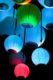 Chinese paper lanterns on a black background. Group of colored paper lanterns glowing in the dark Stock Photography