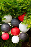 Chinese Paper Lanterns. White, red, and black Chinese paper lanterns for decor at a wedding Royalty Free Stock Photo