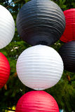 Chinese Paper Lanterns. White, red, and black Chinese paper lanterns for decor at a wedding Royalty Free Stock Photos