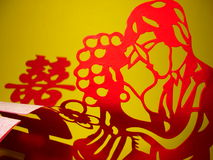 Chinese Papercutting:Red double happiness and couple(horizontal) Royalty Free Stock Photography