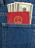 Chinese passport and dollar bills Royalty Free Stock Image