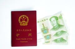 Chinese passport and money Royalty Free Stock Photo