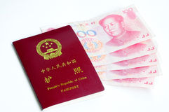 Chinese passport and money Royalty Free Stock Photos