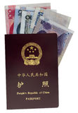 Chinese passport and money Stock Images