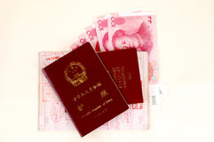 Chinese passport, stamps and money. Chinese passport, European passport, stamps from border and Chinese banknotes Stock Photo