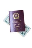 Chinese passport and US Dollars Stock Image