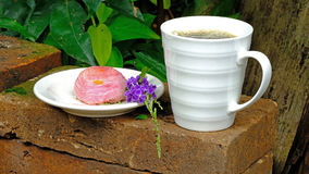 Chinese pastry and a a cup of coffee Stock Photography