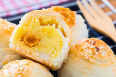 Chinese pastry with egg yolk and white sesame. Closeup chinese pastry with egg yolk and white sesame Royalty Free Stock Images