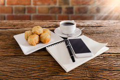 Chinese pastry moon cake with cup of coffee, pen, notebook, smartphone royalty free stock photos