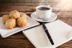 Chinese pastry moon cake with cup of coffee, pen, notebook, smar Royalty Free Stock Photos