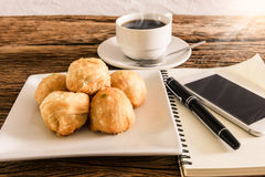 Chinese pastry moon cake with cup of coffee, pen, notebook, smar Royalty Free Stock Photography