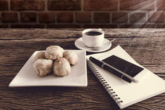 Chinese pastry moon cake with cup of coffee, pen, notebook, smar Stock Photos