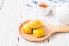 Chinese pastry or moon cake filled with mung bean paste and salted egg yolk. Asian dessert stock image
