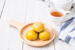 Chinese pastry or moon cake filled with mung bean paste and salted egg yolk. Asian dessert royalty free stock photos