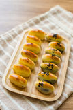 Chinese Pastry row on wooden tray Royalty Free Stock Photos