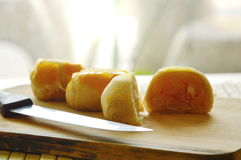 Chinese Pastry Stuffed Mashed Bean And Salty Egg Yolk On Chop Block Stock Photos