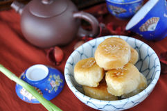 Chinese Pastry with Tea Pot on Background Royalty Free Stock Photography