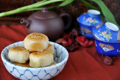 Chinese Pastry with Tea set on Background. Bowl of Chinese pastry with tea set on background Stock Photography