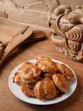 Chinese pastry and wooden dragon Stock Photos