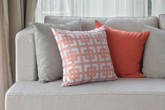 Chinese pattern in orange with deep orange and gray pillows stock photos