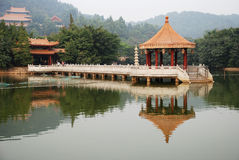 Chinese pavilion. A marble pavilion in the middle of the lake,of Chinese traditional garden architecture ,Buddhist Temple architecture building。There is a Royalty Free Stock Photo