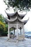 Chinese pavilion. Is beset with trees and flowers Royalty Free Stock Images