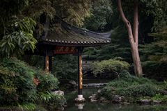 Chinese pavilion in botanical garden stock photos