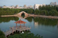 Chinese pavilion and bridge Stock Photos