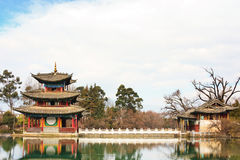 Chinese pavilion on a lake. Here is Black Dragon Lake which is located in Lijiang, Yunnan, China. It's a famous landmark of Lijiang Stock Image