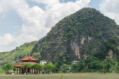 Chinese pavilion located near the mountains Stock Image