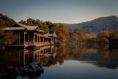Chinese Pavilion on Peaceful Lake. A Chinese Pavilion stands on a peaceful lake that is located in the Hangzhou city, Zhejiang Province. It's near the famous Stock Image