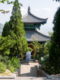 Chinese pavilion with round gate. Dengfeng, China - July 28, 2013: Chinese pavilion in sacred taoist Songshan mountains in Henan province Stock Image
