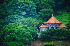 Chinese pavilion and temples at the Chinese Garden within a park with trees. A Chinese pavilion and temples at the Chinese Garden within a park with trees royalty free stock photography