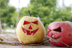 Chinese pear and apple for halloween Royalty Free Stock Images