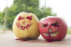Chinese pear and apple for halloween Royalty Free Stock Photo