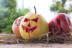 Chinese pear and apple for halloween Stock Photos