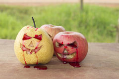 Chinese pear and apple for halloween Royalty Free Stock Photography