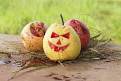 Chinese pear and apple for halloween Stock Images