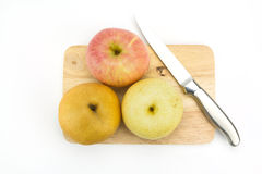 Chinese Pear,Apple,Knife on chopping board Royalty Free Stock Photography