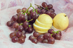 Chinese pear and grape Stock Photos