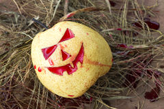 Chinese pear for halloween. Chinese pear on hey for Halloween royalty free stock image
