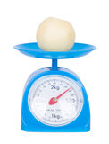 Chinese pear on kitchen scale isolated on white background Royalty Free Stock Photos